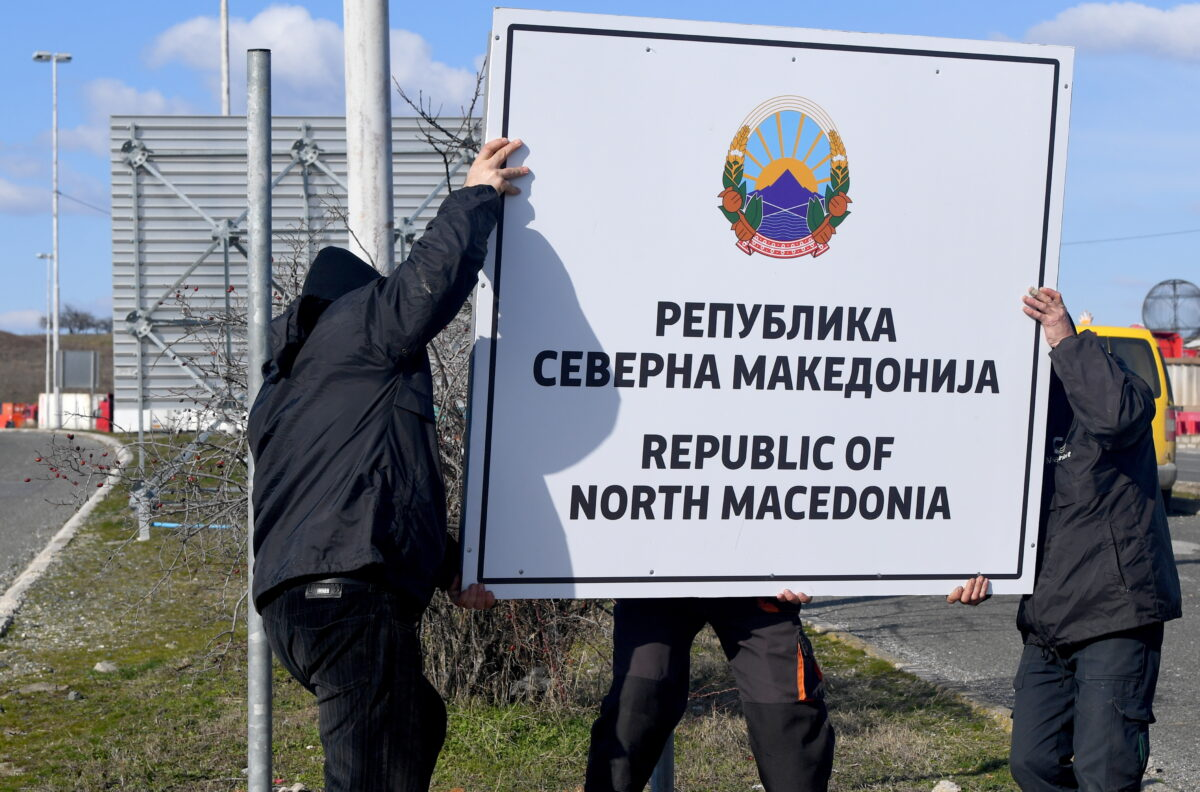 epa07366638 Workers with the new country name on the sign board, at the border crossing Bogorodica between North Macedonia and Greece on 13 February 2019. FYR of Macedonia Government is due change the name of country after ratification of the Protocol of the North Atlantic Treaty for the Accession of Republic of North Macedonia whereby Greece will approve the accession of its northern neighbor to NATO under its new name, as provided by the Prespes Agreement signed by Athens and Skopje. EPA/GEORGI LICOVSKI