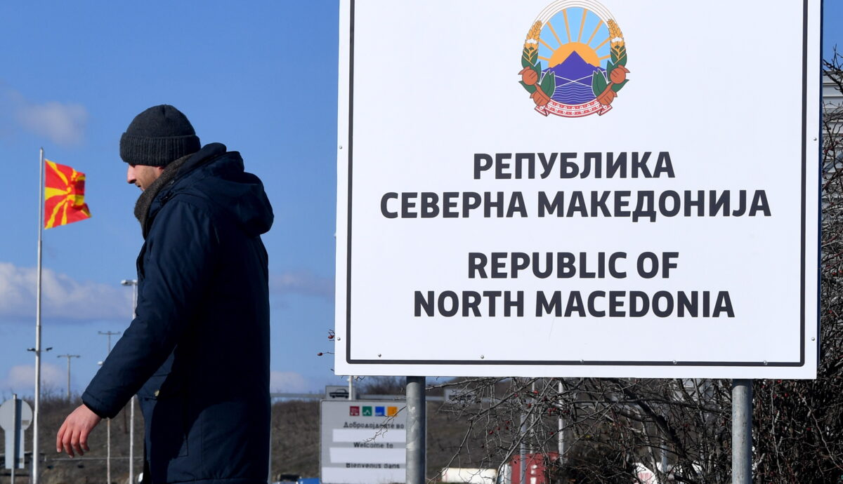 epa07366637 A man passes the new country name North Macedonia sign board, at the border crossing Bogorodica between North Macedonia and Greece on 13 February 2019. FYR of Macedonia Government is due change the name of country after ratification of the Protocol of the North Atlantic Treaty for the Accession of Republic of North Macedonia whereby Greece will approve the accession of its northern neighbor to NATO under its new name, as provided by the Prespes Agreement signed by Athens and Skopje. EPA/GEORGI LICOVSKI