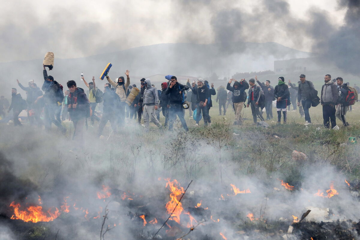 Migrants and refugees remain protesting in a makesift camp in Diavata, northern Greece