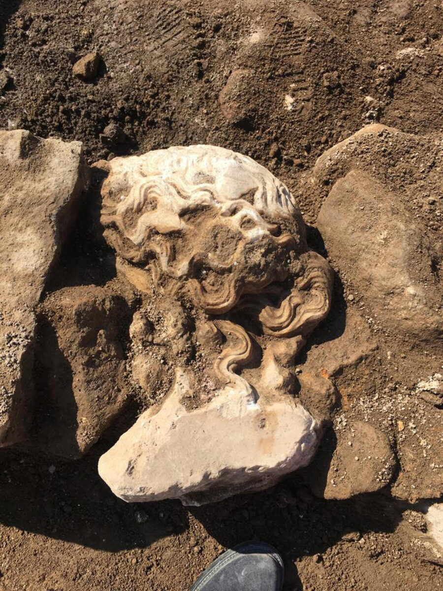 The head of a deity emerges during excavations under Rome Town Hall