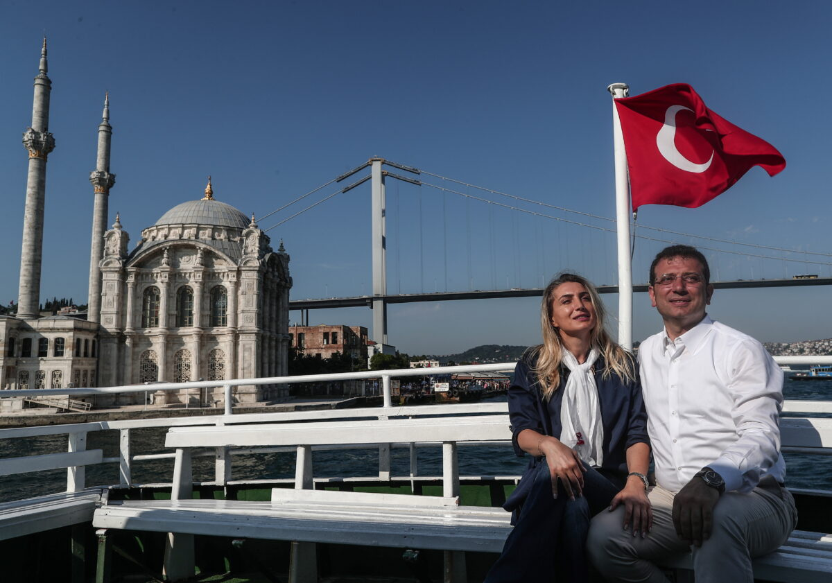 epa07666535 Republican People's Party 'CHP' candidate for Istanbul mayor Ekrem Imamoglu (R) and his wife Dilek Imamoglu (L) pose for media as they travel with ferry around Bosphorus after his last repeated election campaign rally in Istanbul, Turkey, 22 June 2019. According to media reports, the Turkish Electoral Commission has ordered a repeat of the mayoral election in Istanbul on 23 June, after Turkish President Recep Tayyip Erdogan's AK Party had alleged there was 'corruption' behind his party losing. EPA/SEDAT SUNA