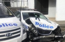In this Monday, July 22, 2019, photo provided by New South Wales Police, a damaged police vehicle is parked at a police station in Sydney. Police have charged a driver after methylamphetamine valued at more than $140 million was found in a van that crashed into police cars parked outside the Sydney police station. (NSW Police via AP)