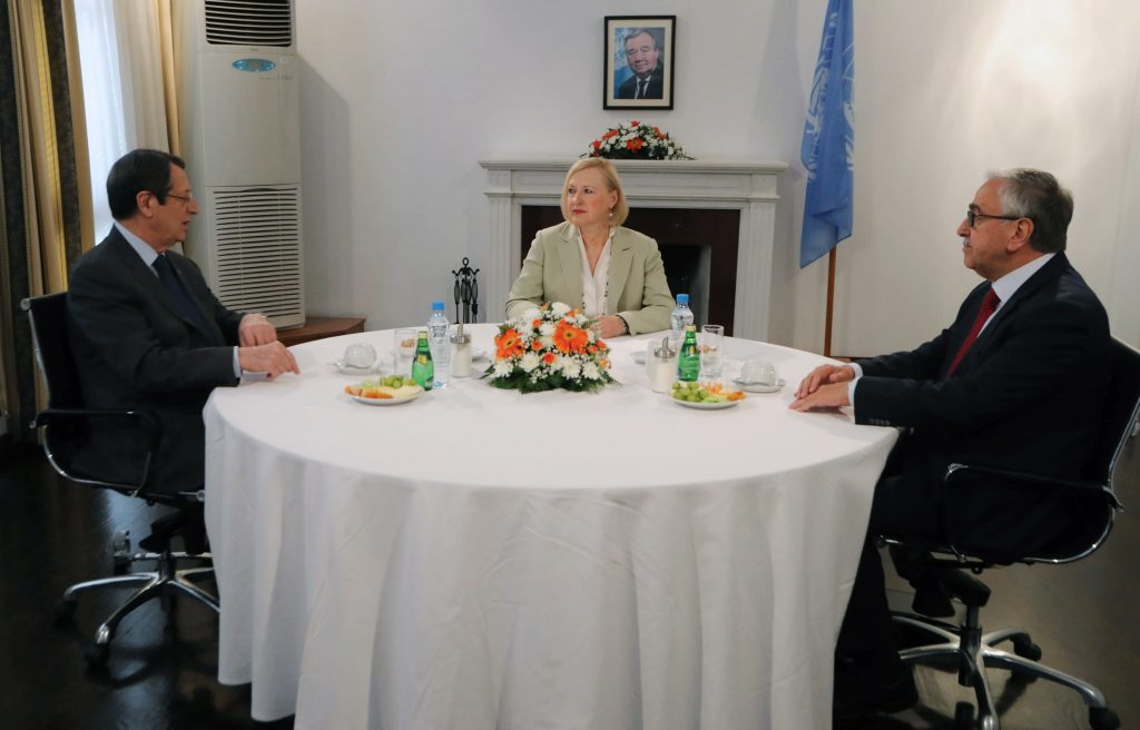 epa07763449 A handout photo made available by the Cypriot government's Press and Information Office (PIO) shows Deputy Special Adviser to the Secretary-General on Cyprus Elizabeth Spehar (C) with Cyprus President Nicos Anastasiades (L) and Turkish Cypriot leader Mustafa Akinci during their meeting in the buffer zone of Nicosia airport, Cyprus, 09 August 2019. Leaders of Greek and Turkish Cypriot communities met on the day for a round of UN-led talks; an attempt to revive formal peace talks for the potential reunification of the Mediterranean island. Cyprus has been divided since 1974 when Turkey invaded and occupied the northern half of the island.  EPA/CYPRIOT PRESS OFFICE HANDOUT  HANDOUT EDITORIAL USE ONLY/NO SALES