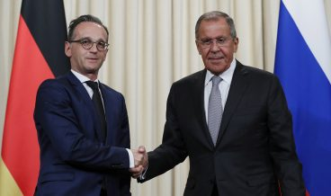 epa07784407 German Foreign Minister Heiko Maas (L) shakes hands with Russian Foreign Minister Sergei Lavrov after their press conference in Moscow, Russia, 21 August 2019.  EPA/YURI KOCHETKOV