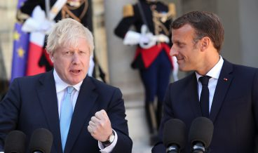 epa07785595 French President Emmanuel Macron (R) and British Prime Minister Boris Johnson (L) give a press conference prior to their  meeting at the Elysee Palace in Paris, France, 22 August 2019. Johnson is in Paris after a one day visit in Berlin.  EPA/CHRISTOPHE PETIT TESSON