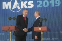 epa07796979 Russian President Vladimir Putin (R) and Turkish President Recep Tayyip Erdogan (L) shake hands during the opening of the MAKS-2019 International Aviation and Space Salon in Zhukovsky outside Moscow, Russia, 27 August 2019. Turkish President is on a short working visit in Russia.  EPA/MAXIM SHIPENKOV/ POOL