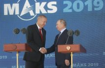 epa07797059 Russian President Vladimir Putin (R) and Turkish President Recep Tayyip Erdogan (L) shake hands during the opening of the MAKS-2019 International Aviation and Space Salon in Zhukovsky outside Moscow, Russia, 27 August 2019. Turkish President is on a short working visit in Russia.  EPA/MAXIM SHIPENKOV/ POOL