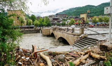 This photo taken on August 21, 2019 shows the aftermath of a mudslide caused by heavy rainfall in Wenchuan county, in China's southwestern Sichuan province. - Nine people have died and 35 are still missing after a series of mudslides in China's southwestern Sichuan province, local authorities said on August 22. (Photo by STR / AFP) / China OUT